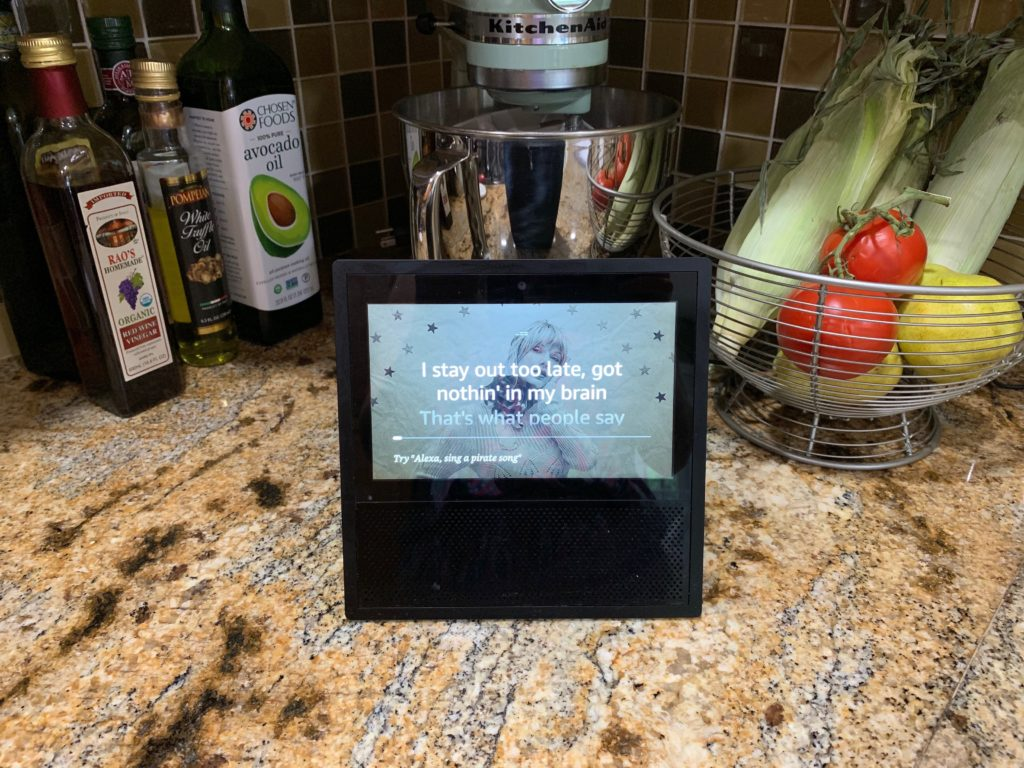An Echo Show playing a Taylor Swift song and showing the lyrics